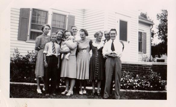 Martha Elstad Gustavson, Sheldon Sumner, Olga Elstad Sumner, Virginia Sumner Coats holding Karol Konzen, Karl Konzen, Yvonne Sumner Konzen, Ella Kuske Konzen, John Konzen, and Kermit Konzen  in 1940.